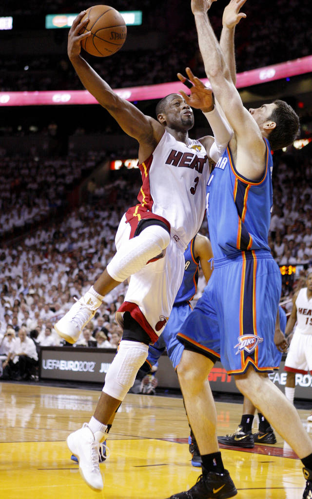 Miami's Dwyane Wade (3) goes to the basket past Oklahoma City's Nick Collison (4) during Game 4 of the NBA Finals between the Oklahoma City Thunder and the Miami Heat at American Airlines Arena, Tuesday, June 19, 2012. Oklahoma City lost 104-98.  Photo by Bryan Terry, The Oklahoman