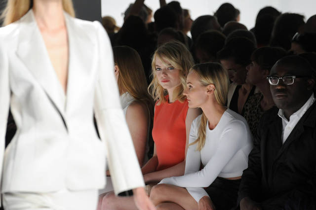 <p>Emma Stone, left, and Diane Kruger, left to right, attend the Calvin Klein Spring 2013 show, Thursday, Sept. 13, 2012, during Fashion Week in New York. (Photo by Diane Bondareff/Invision/AP Images)</p>