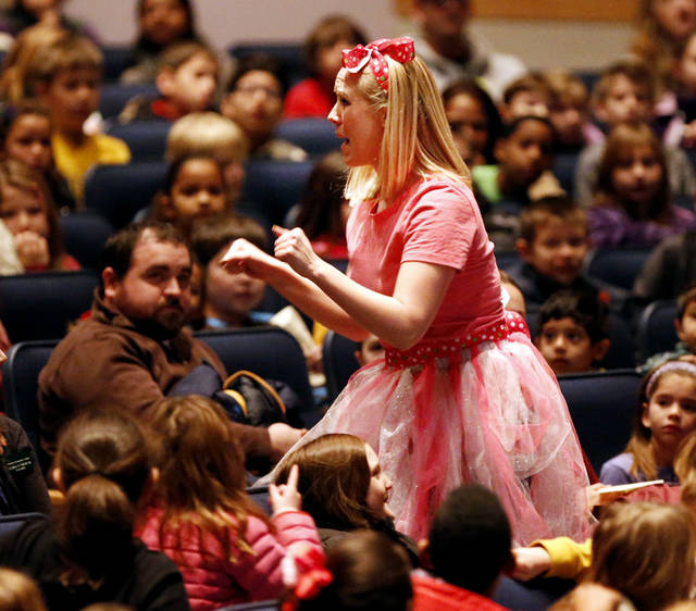"Fumbelina, played by Kristin Fitzgerald, interacts with third-graders Thursday at a Cimarron Opera Company performance of ""Fumbelina"" at the Nancy O'Brian Performing Arts Center. PHOTO BY STEVE SISNEY, THE OKLAHOMAN <strong>STEVE SISNEY</strong>"
