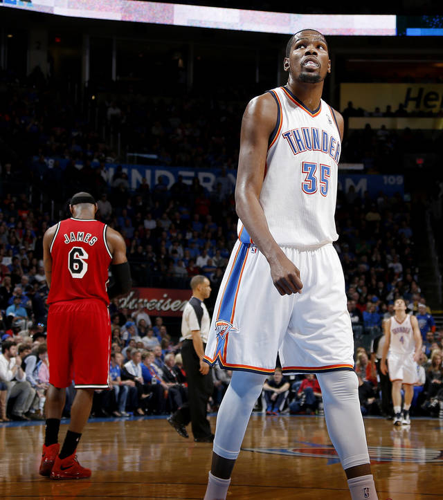 Oklahoma City's Kevin Durant (35) looks up as Miami's LeBron James (6) walks off the court during an NBA basketball game between the Oklahoma City Thunder and the Miami Heat at Chesapeake Energy Arena in Oklahoma City, Thursday, Feb. 15, 2013. Photo by Bryan Terry, The Oklahoman
