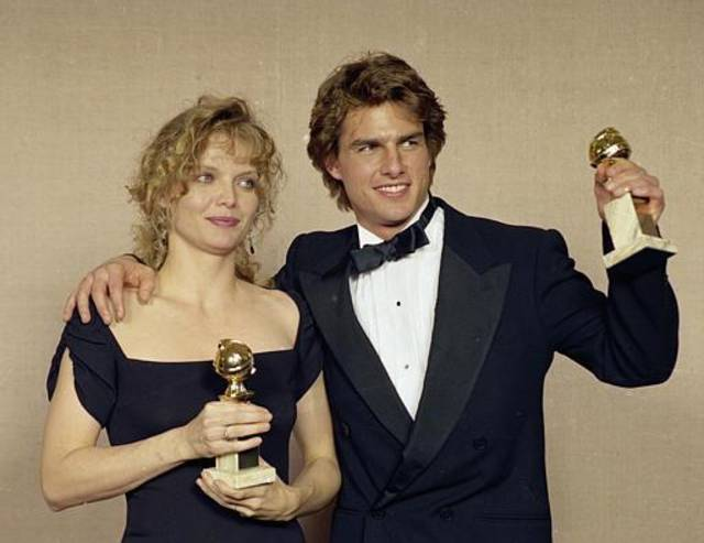 "Actors Michelle Pfeiffer and Tom Cruise display their awards at the 47th Annual Golden Globe Awards in Beverly Hills, Calif., Jan. 21, 1990.  Pfeiffer won Best Performance in ""The Fabulous Baker Boys,"" and Cruise won for his performance in ""Born on the Fourth of July.""  (AP Photo/Doug Pizac)"