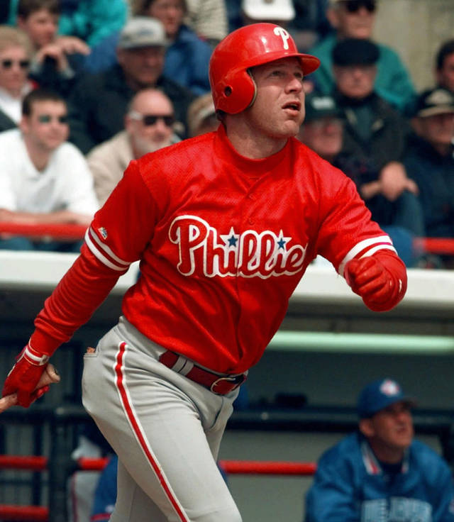 FILE - In this March 10, 1998, file photo, Philadelphia Phillies' Lenny Dykstra watches the flight of his triple in the third inning of a spring training baseball game against the Toronto Blue Jays in Dunedin, Fla. Dykstra was sentenced Monday, Dec. 3, 2012, to 6½ months in prison for hiding baseball gloves and other heirlooms from his playing days that were supposed to be part of his bankruptcy filing, capping a tumultuous year of legal woes. (AP Photo/Pat Sullivan, File)