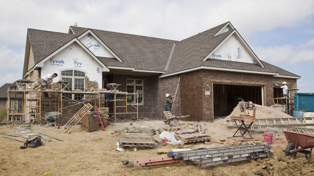   In this March 14, 2012 photo, construction workers build a new home in Wichita, Kan. Kansas home sales rebounded this year, and are forecast to rise another 6.3 percent in 2013, as the economy improves and pent-up demand brings people back into the housing market, economic researchers at Wichita State University said Thursday, Oct. 11, 2012. (AP Photo/The Wichita Eagle, Mike Hutmacher)  