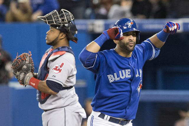Toronto Blue Jays' Jose Bautista, right, celebrates next to Cleveland Indians catcher Carlos Santana after hitting a two-run home run during the first inning of a baseball game in Toronto on Thursday, April 4, 2013. (AP Photo/The Canadian Press, Chris Young)