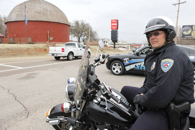 Edmond police officer Tim Ivy watches passing drivers.  By Paul Hellstern, The Oklahoman Archives