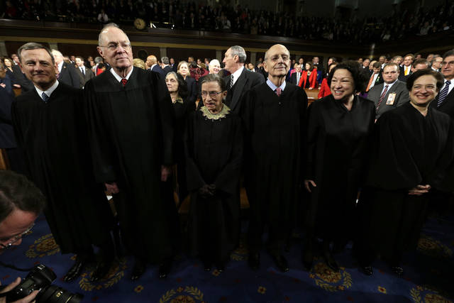 Supreme Court Justices, from left, Chief Justice John Roberts, Anthony Kennedy, Ruth Bader Ginsburg, Stephen Breyer, Sonia Sotomayor and Elena Kagan await the start of President Barack Obama's State of the Union address during a joint session of Congress on Capitol Hill in Washington, Tuesday Feb. 12, 2013. (AP Photo/Charles Dharapak, Pool) ORG XMIT: CAP509