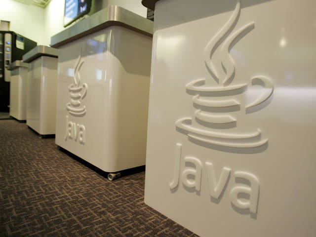 FILE- This April 23, 2007 file photo shows the Java logo at Sun Microsystems' offices in Menlo Park, Calif. On Monday, Jan. 14, 2013, Oracle says it has released a fix for the flaw in its Java software that raised an alarm from the U.S. Department of Homeland Security last week. (AP Photo/Paul Sakuma, File)