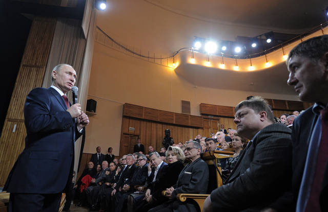 Russian Prime Minister and presidential candidate Vladimir Putin addresses election activists in Moscow on Tuesday, Feb. 7, 2012. (AP Photo/RIA Novosti, Alexei Druzhinin, Government Press Service)