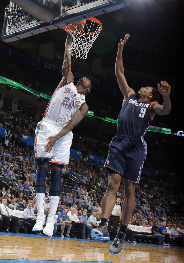 Oklahoma City's DeAndre Liggins (25) dunks in front of Charlotte's Gerald Henderson (9) during the preseason NBA game between the Oklahoma City Thunder and the Charlotte Bobcats at Chesapeake Energy Arena in Oklahoma City, Tuesday, Oct. 16, 2012. Photo by Sarah Phipps, The Oklahoman