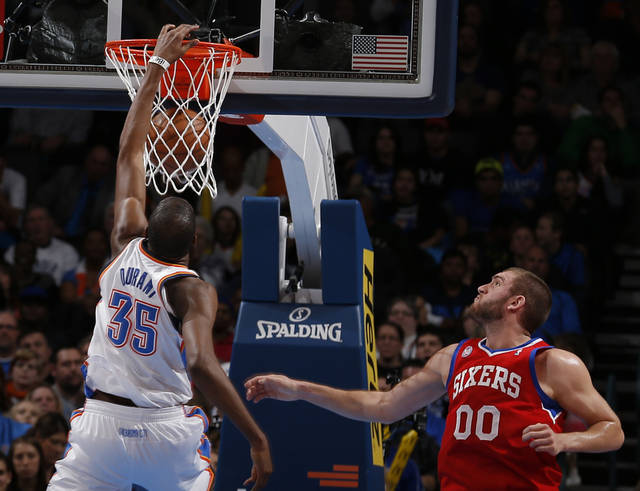 Oklahoma City's Kevin Durant (35) dunks in front of Philadelphia's Spencer Hawes (00) during the NBA game between the Oklahoma City Thunder and the Philadelphia 76ers at the Chesapeake Energy Arena in Oklahoma City, Friday,Jan. 4, 2013. Photo by Sarah Phipps, The Oklahoman