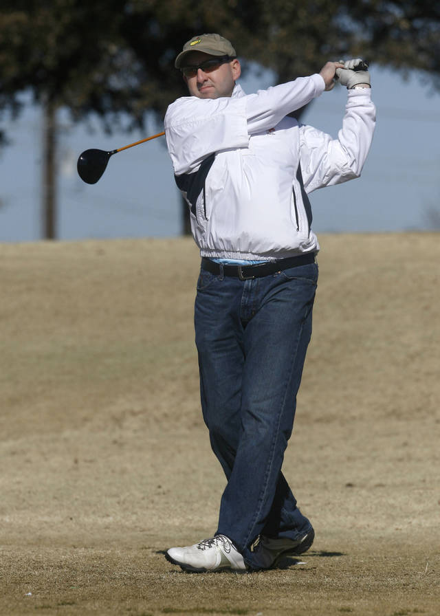 Cameron Carrier tees off during the 11th Annual KickingBird two-man Iron Man Golf Tournament at KickingBird Golf Club in Edmond, OK, Saturday, Jan. 31, 2009. BY PAUL HELLSTERN, THE OKLAHOMAN