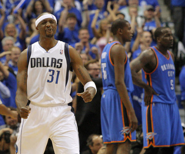 Jason Terry (31) of Dallas reacts in front of Oklahoma City's Kevin Durant (35) and Kendrick Perkins (5) during game 1 of the Western Conference Finals in the NBA basketball playoffs between the Dallas Mavericks and the Oklahoma City Thunder at American Airlines Center in Dallas, Tuesday, May 17, 2011. Photo by Bryan Terry, The Oklahoman
