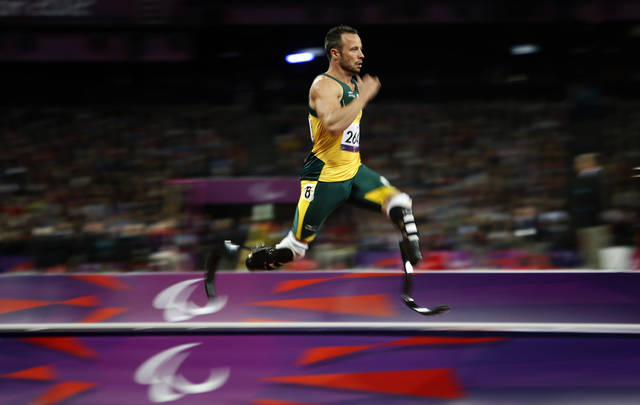 South Africa's Oscar Pistorius competes during a men's 200m T44 round 1 at the 2012 Paralympics in London, Saturday, Sept. 1, 2012. Pistorius ran a new world record in the race of 21.30 seconds. (AP Photo/Emilio Morenatti)