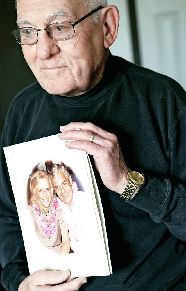 Lloyd Leveridge with a picture of himself and his wife at his home Wednesday in Oklahoma City. Lloyd's wife has Alzheimer's and recently moved into a nursing facility. Photo By John Clanton, The Oklahoman