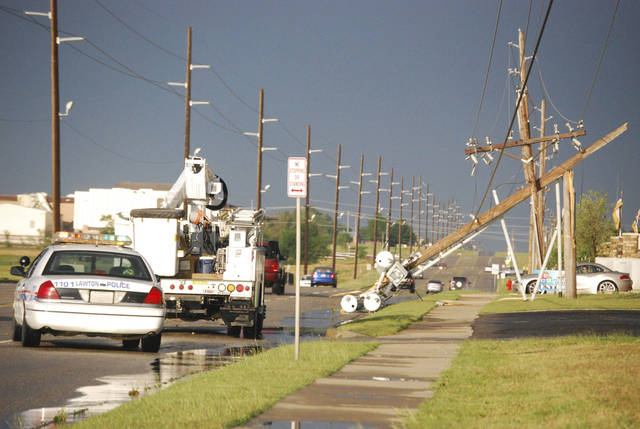 Downed  power poles are seen on the east side of Lawton, Okla., after a storm Monday, May, 28, 2012. Winds of 65 miles per hour were clocked nearby in Fletcher, Okla., and hail up to tennis-ball size was reported.  (AP Photo/The Constitution, Jeff Dixon) ORG XMIT: OKLAW101