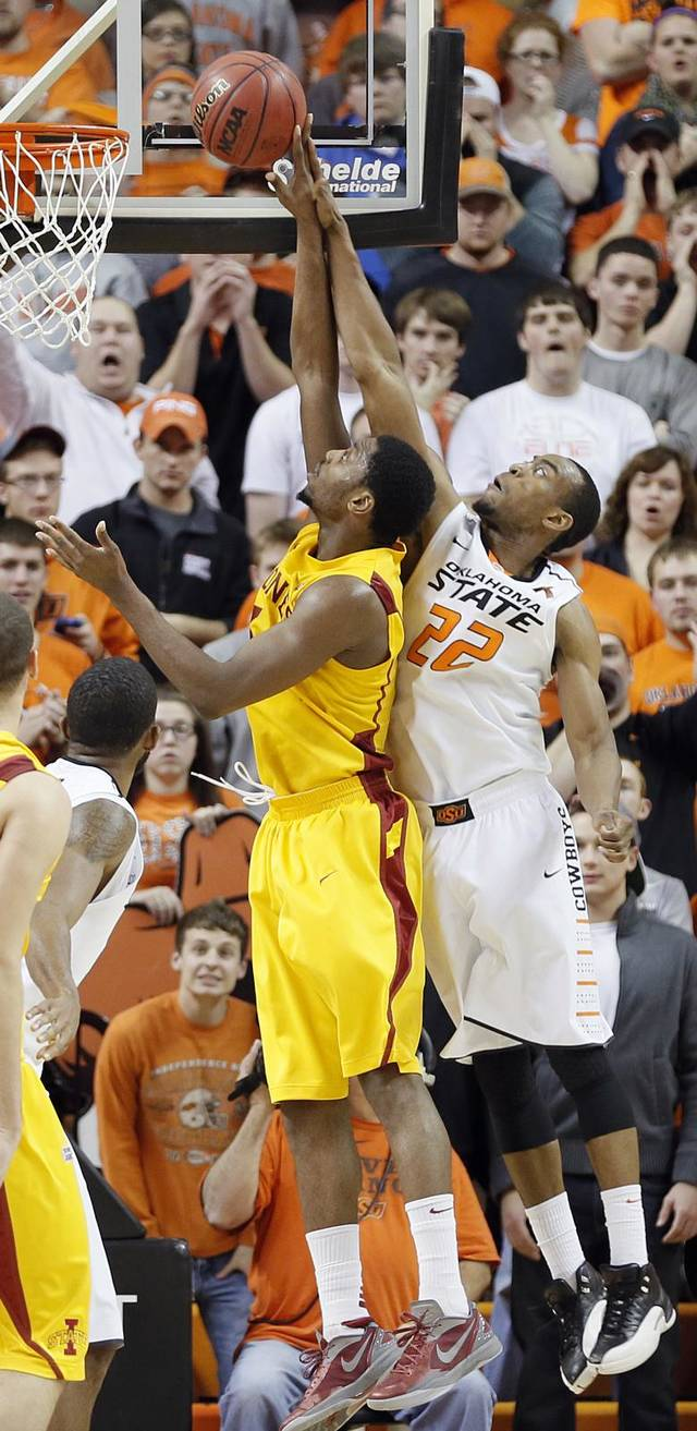 Oklahoma State Cowboys' Markel Brown (22) defends a shot on Iowa State Cyclones' Melvin Ejim (3) during the college basketball game between the Oklahoma State University Cowboys (OSU) and the Iowa State University Cyclones (ISU) at Gallagher-Iba Arena on Wednesday, Jan. 30, 2013, in Stillwater, Okla.  Photo by Chris Landsberger, The Oklahoman