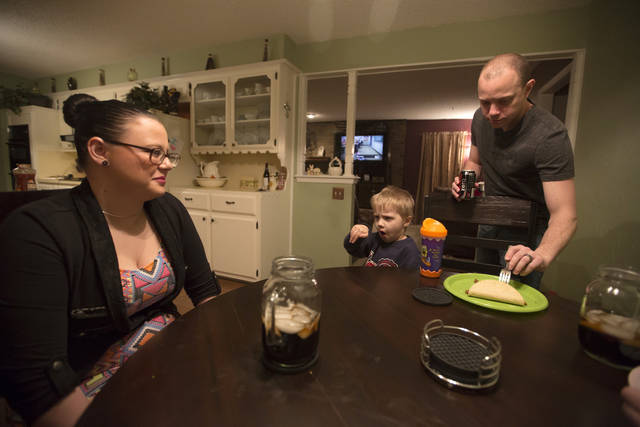 Lauren Sloan-Prince  has dinner with her husband, Joe, and her son, Nakona, 4, at her aunt�s home Thursday in Moore. Photo by Garett Fisbeck, For The Oklahoman