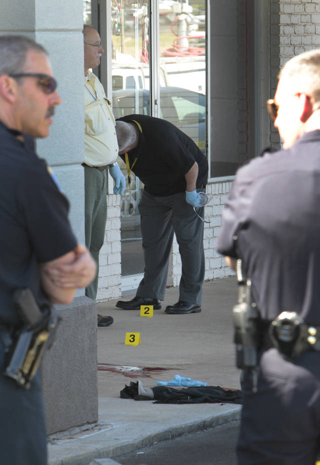Police work an officer-involved shooting at Los Arcos Mexican Restaurant in Edmond, Tuesday, March 13, 2012.  Photo By David McDaniel/The Oklahomen