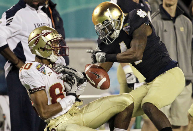 Florida State wide receiver Rashad Greene (80) catches a 42-yard pass in front of Notre Dame cornerback Gary Gray, right, during the second half of the Champs Sports Bowl NCAA college football game, Thursday, Dec. 29, 2011, in Orlando, Fla. Florida State won 18-14. (AP Photo/John Raoux)