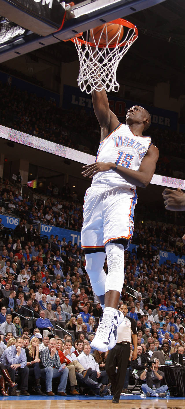 Reggie Jackson (15) dunks during an NBA basketball game between the Oklahoma City Thunder and the Los Angeles Lakers at Chesapeake Energy Arena in Oklahoma City, Thursday, Feb. 23, 2012. Photo by Bryan Terry, The Oklahoman