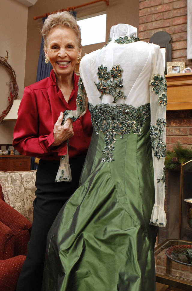 "Elizabeth ""Betty"" Sullivan shows the gown a Broadway designer made especially for her on Thursday, Dec. 15, 2011, in Norman, Okla.   Photo by Steve Sisney, The Oklahoman ORG XMIT: KOD"