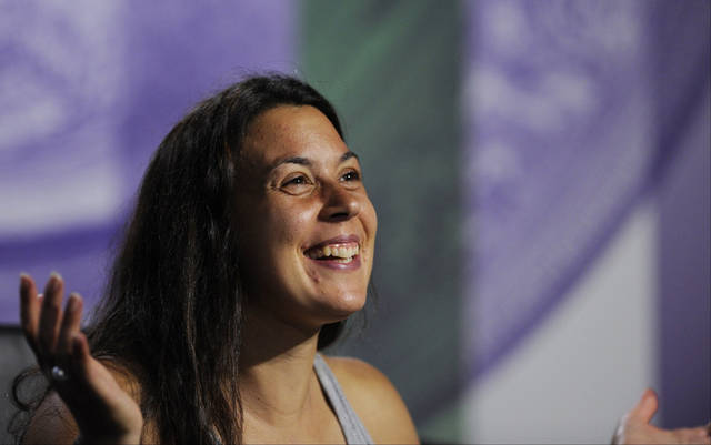 Marion Bartoli of France speaks at a news conference after winning the Women's singles final match against Sabine Lisicki of Germany at the All England Lawn Tennis Championships, Wimbledon, London, Saturday, July 6, 2013. (AP Photo/AELTC, Tom Lovelock)