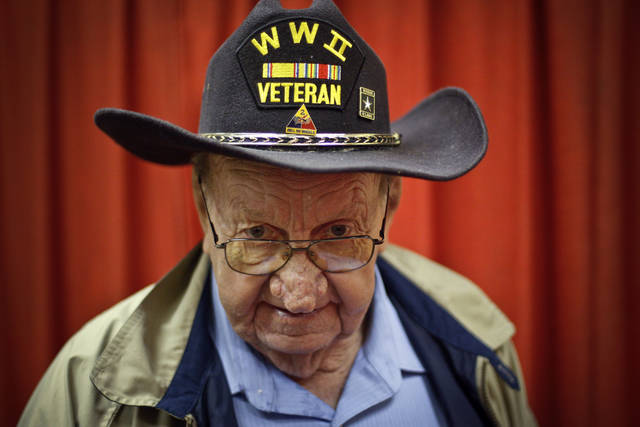World War II veteran Charles Murphy proudly wears his hat during a visit by blind and visually impaired veterans to the 45th Infantry Division Museum on Monday, April 25, 2011, in Oklahoma City, Okla.  Photo by Chris Landsberger, The Oklahoman