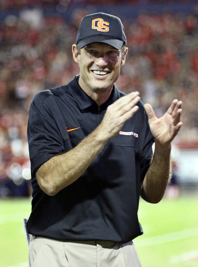 Oregon State coach Mike Riley cheers up his team before an NCAA college football game against Arizona at Arizona Stadium in Tucson, Ariz., Saturday, Sept. 29, 2012. (AP Photo/Wily Low)