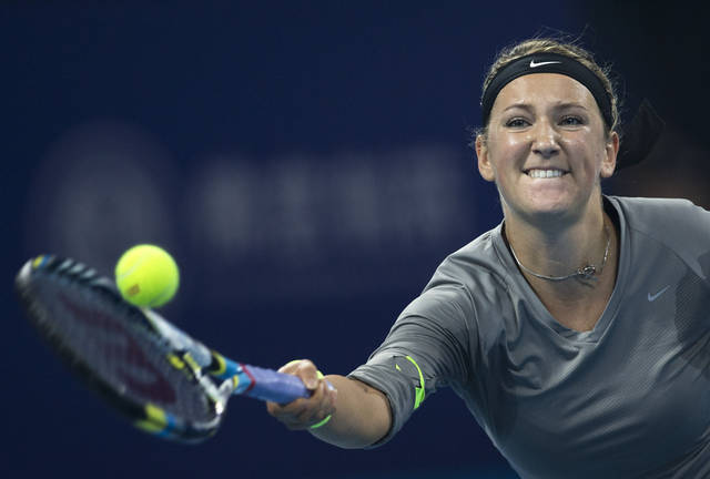 Belarus' Victoria Azarenka hits a return shot to Maria Sharapova of Russia during their women's singles final match at the China Open tennis tournament in Beijing Sunday, Oct. 7, 2012. (AP Photo/Andy Wong)