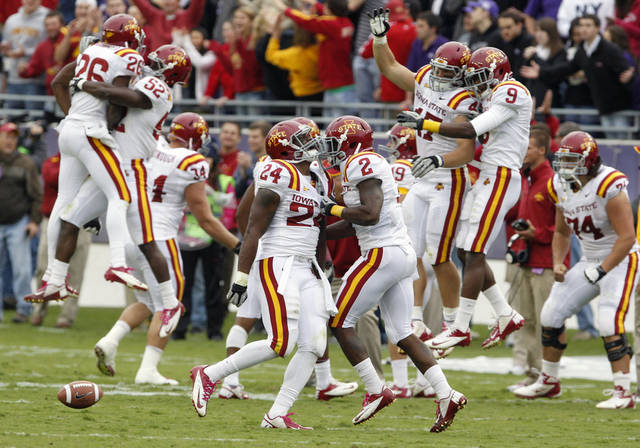 Iowa State defensive back Durrell Givens (24) celebrates his fumble recovery with Jansen Watson (2) as teammates also react during the first half of an NCAA college football game against TCU, Saturday, Oct. 6, 2012, in Fort Worth, Texas. (AP Photo/LM Otero)