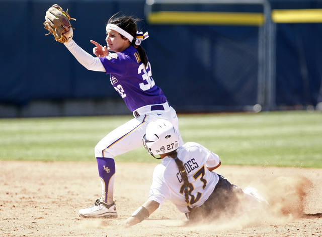 LSU's Allison Falcon catches the ball as California's Cheyenne Cordes slides into second base during a Women's College World Series softball game in Oklahoma City, Thursday, May 31, 2012. California won 5-3. (AP Photo/Alonzo Adams)