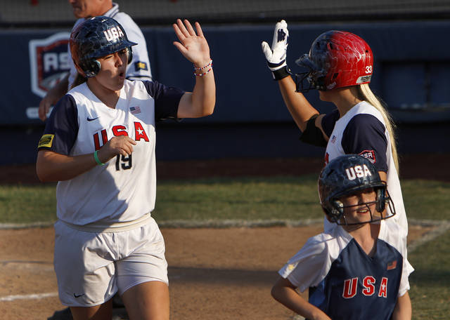 Team USA's Amanda Chidester (19) celebrates with Jessica Shults (33) after scoring a run during a World Cup of Softball game between USA and Puerto Rico at ASA Hall of Fame Stadium in Oklahoma City, Thursday, June 28, 2012.  Photo by Garett Fisbeck, The Oklahoman