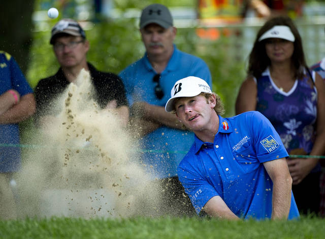 Brandt Snedeker, of the United States, blasts out of the bunker on the eighth hole during the second round at the Canadian Open golf tournament at Glen Abbey in Oakville, Ontario, on Friday, July 26, 2013. (AP Photo/The Canadian Press, Nathan Denette)