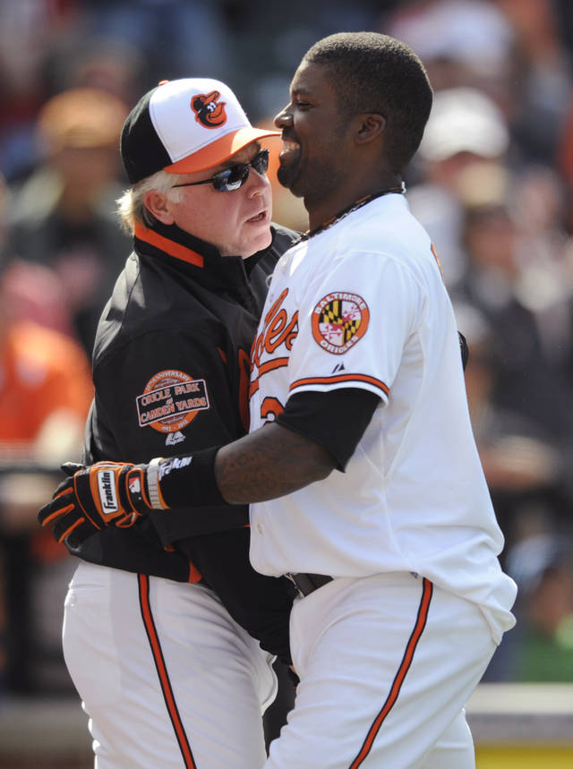 Baltimore Orioles manager Buck Showalter, left, hugs Wilson Betemit after Betemit's three-run home run against the Oakland Athletics during the ninth inning of a baseball game Sunday, April 29, 2012 in Baltimore. The Orioles won 5-2. (AP Photo/Gail Burton)