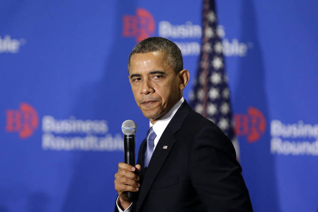 "In this Dec. 5, 2012, photo, President Barack Obama pauses as he speaks about the ""fiscal cliff"" at the Business Roundtable, an association of chief executive officers, in Washington. The political fight that took the nation to the verge of defaulting on its debts last year is back, overshadowed by ""fiscal cliff"" disputes but with consequences far graver than looming tax hikes and steep spending cuts. The government is on track to hit its $16.4 trillion borrowing limit later this month. And while the Treasury can keep the government functioning through early next year, Obama is bluntly insisting that any deal on the ""fiscal cliff"" must include an end to brinkmanship on the debt ceiling.  (AP Photo/Charles Dharapak)"