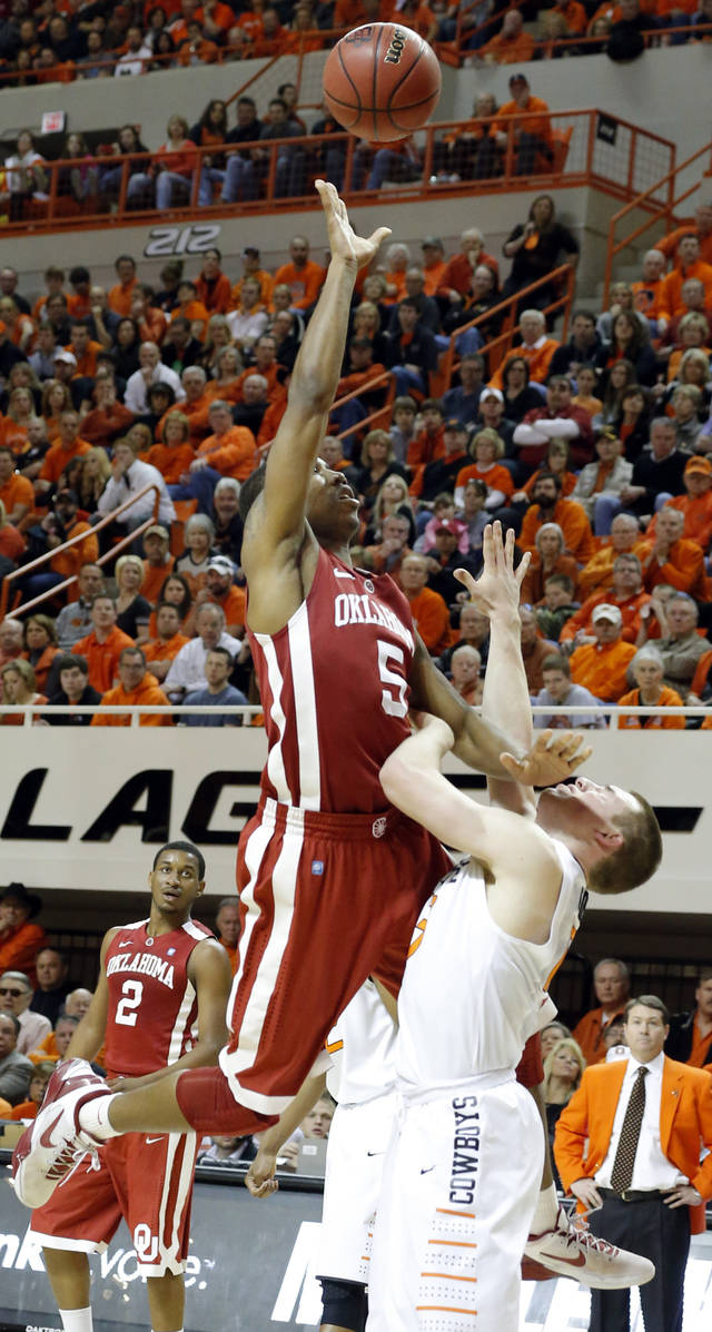 Oklahoma's Je'lon Hornbeak (5) shoots over Oklahoma State's Phil Forte (13) during the Bedlam men's college basketball game between the Oklahoma State University Cowboys and the University of Oklahoma Sooners at Gallagher-Iba Arena in Stillwater, Okla., Saturday, Feb. 16, 2013. Photo by Sarah Phipps, The Oklahoman