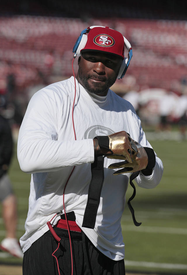 In this Nov. 11, 2012, photo, San Francisco 49ers running back Brandon Jacobs warms up before an NFL football game against the St. Louis Rams in San Francisco. Jacobs has posted advice on Twitter with a reference to never working �in a place where you hate your boss so much.�  The hash tag: �YouLiveAndYouLearn.� Jacobs had terrible timing with the tweet Thursday afternoon, considering San Francisco coach Jim Harbaugh was hospitalized for what the team called a �minor procedure� for an irregular heartbeat. In the locker room soon after his post, Jacobs said people shouldn�t �assume� his remarks were football-related, then followed up with more tweets. He made one post saying that �football is not my life.� (AP Photo/Jeff Chiu)