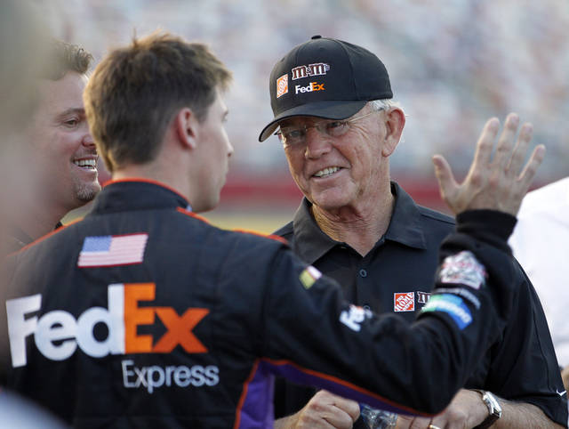 This photo made May 26, 2011 shows team owner Joe Gibbs, right, talking with driver Denny Hamlin, left, before qualifying for the NASCAR Sprint Cup series Coca-Cola 600 auto race in Concord, N.C.. Hamlin and Joey Logano have been dogged for a month by rumors that crew chief changes are needed, but both drivers insist they want personnel left alone. (AP Photo/Terry Renna)