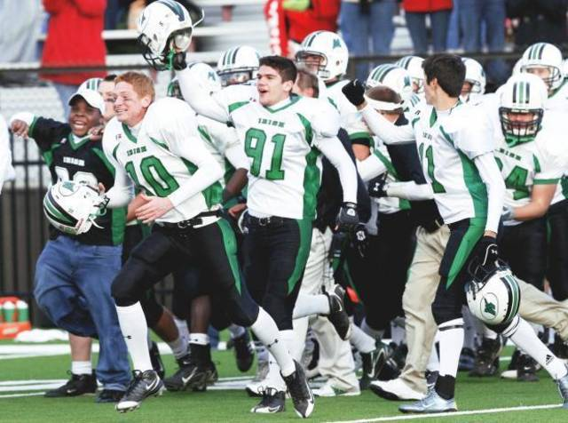 McGuinness players celebrate after defeating Grove in the Class 4A semifinals. PHOTO BY SHERRY BROWN, TULSA WORLD