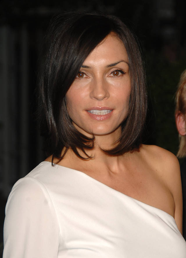 Actress Famke Janssen arrives at the CFDA Fashion Awards in New York on Monday, June 2, 2008. (AP Photo/Peter Kramer) ORG XMIT: NYPK218