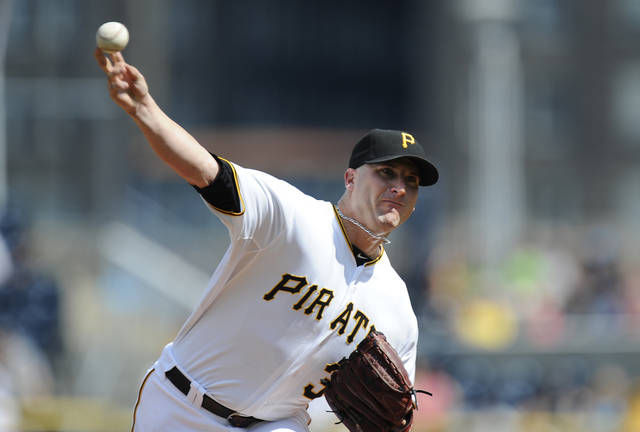 Pittsburgh Pirates starting pitcher Brad Lincoln throws to a Detroit Tigers batter during the first inning of a baseball game Saturday, June 23, 2012, in Pittsburgh. (AP Photo/Don Wright)