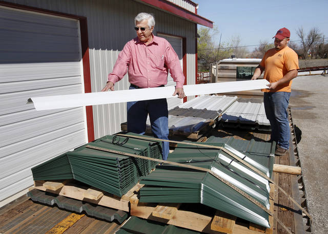 Joe Inda, left,  and Donald Clagg inspect a load of finished metal sheets being trucked to Cashion.  Joe Inda is CEO of Indaco Metals, in Shawnee.  Photo taken Tuesday,  March 13, 2012.   Photo by Jim Beckel, The Oklahoman