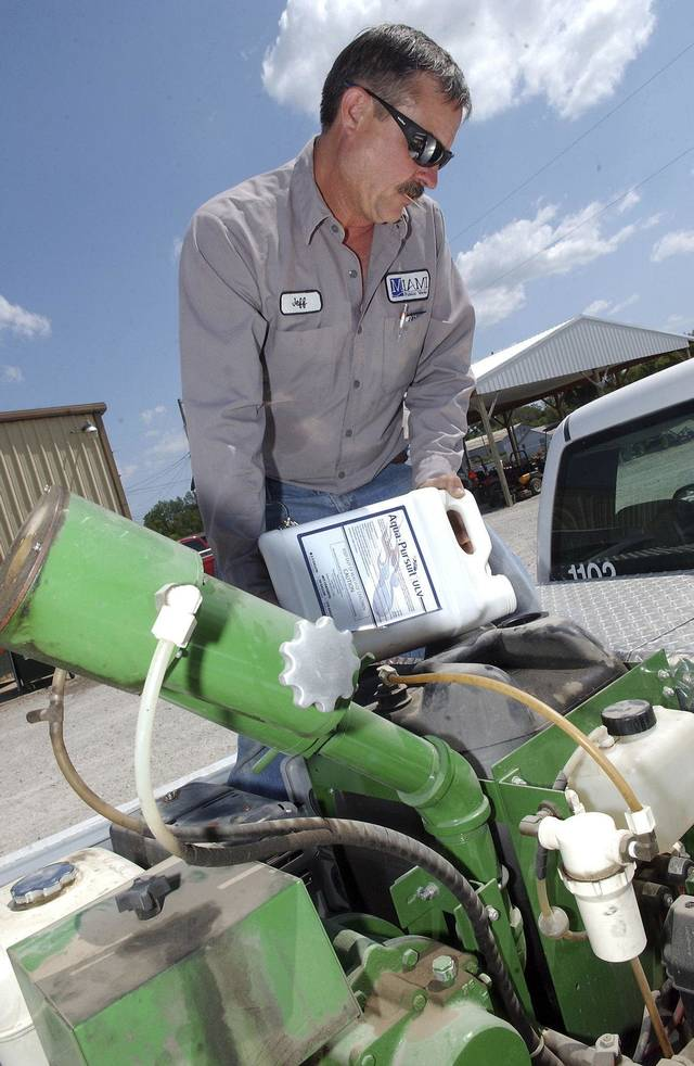 Jeff Mahurin, a Miami, OK, city employee, works to get a mosquito fogger ready for controlling mosquitoes in Miami. Gary Crow, for The Oklahoman