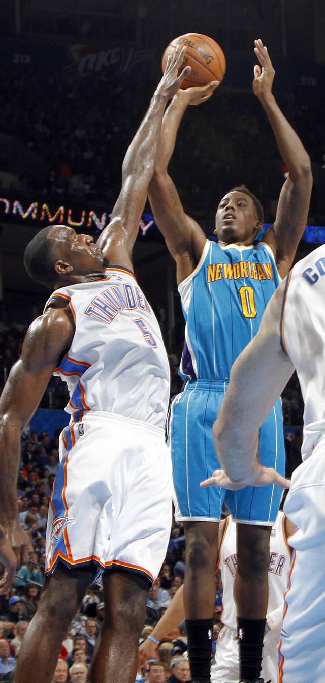 Oklahoma City Thunder's Kendrick Perkins (5) defends on New Orleans Hornets' Al-Farouq Aminu (0) during the NBA basketball game between the Oklahoma CIty Thunder and the New Orleans Hornets at the Chesapeake Energy Arena on Wednesday, Dec. 12, 2012, in Oklahoma City, Okla.   Photo by Chris Landsberger, The Oklahoman