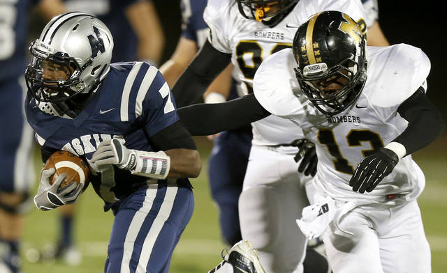 Edmond North's Marque Depp runs past  Midwest City's Tyquae Russell during their high school football game at Wantland Stadium in Edmond, Thursday, October 25, 2012. Photo by Bryan Terry, The Oklahoman