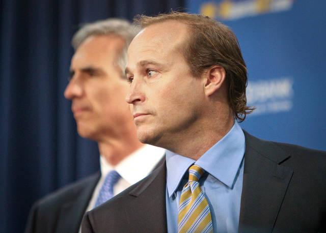 West Virginia University athletic director Oliver Luck, left, and college football head coach Dana Holgorsen, right, take questions during a news conference in Morgantown, W.Va. on Friday, June 10, 2011. Holgorsen was appointed head football coach and Bill Stewart resigned. (AP Photo/David Smith) ORG XMIT: WVDS103