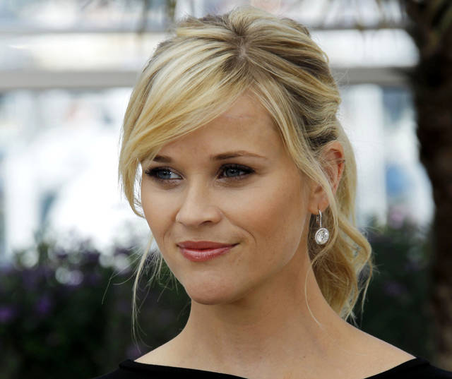 "FILE - This May 26, 2012 file photo shows actress Reese Witherspoon posing during a photo call for ""Mud"" at the 65th international film festival, in Cannes, southern France. The 36-year-old Oscar winner and mother of three will receive the March of Dimes Grace Kelly Award at its Celebration of Babies luncheon Friday Dec. 7, 2012 at the Beverly Hills Hotel.  (AP Photo/Joel Ryan, file)"