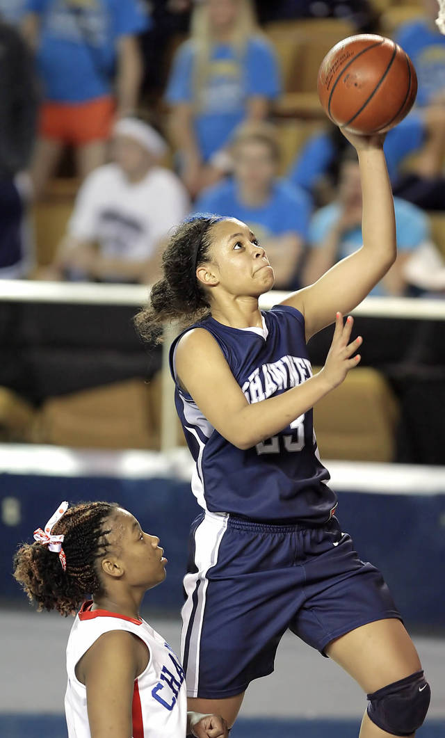 GIRLS HIGH SCHOOL BASKETBALL / STATE TOURNAMENT: Shawnee's Kelsee Grovey puts up a shot over Memorial's Ashton Murrell in the 2nd half of their Class 5A quarterfinal state basketball championship game held in Tulsa, OK Mar. 10, 2011. MICHAEL WYKE/Tulsa World
