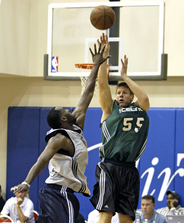 Boston Celtics' Luke Harangody (55) makes a shot over Oklahoma City Thunder's DJ White during the second half of an NBA summer league basketball game in Orlando, Fla., Monday, July 5, 2010.(AP Photo/John Raoux) ORG XMIT: FLJR113