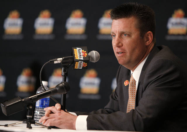 Oklahoma State coach Mike Gundy speaks during a press conference in Paradise Valley, Ariz. Sunday, Jan. 1, 2012. Oklahoma State will play Stanford in the Fiesta Bowl on Monday, January 2, 2012. Photo by Bryan Terry, The Oklahoman